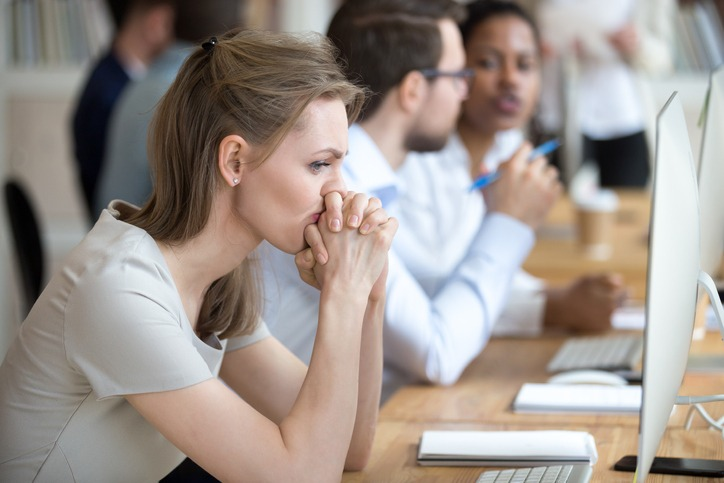 Woman employee having problem and doubts about business moments