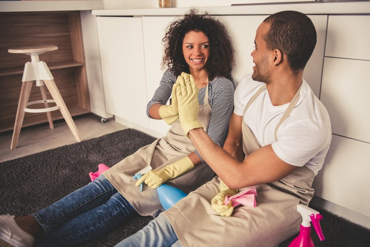 Afro American couple cleaning