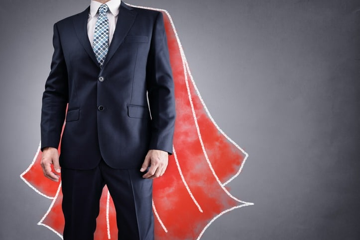 Superhero businessman with red cape concept for leadership