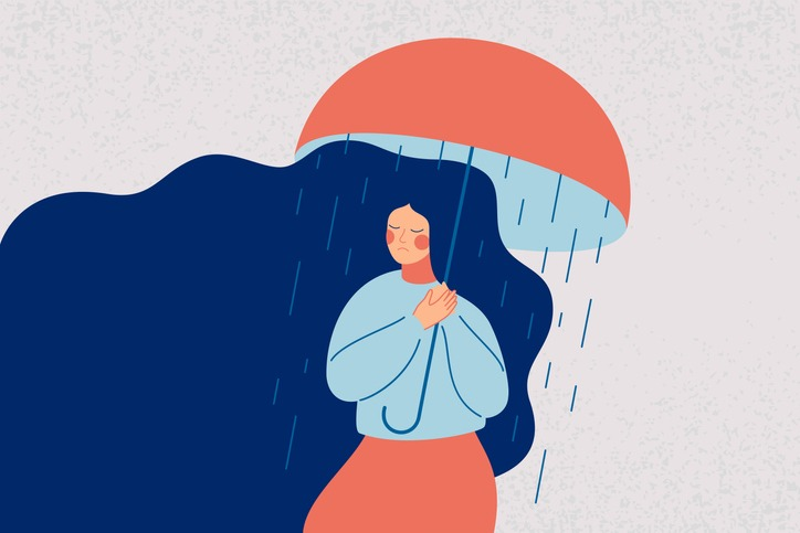 Depressed woman holds an open umbrella, which does not save her from the rain.