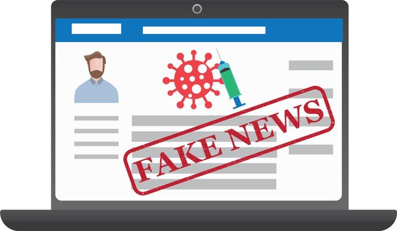 Coronavirus vaccine misinformation on social media on laptop screen