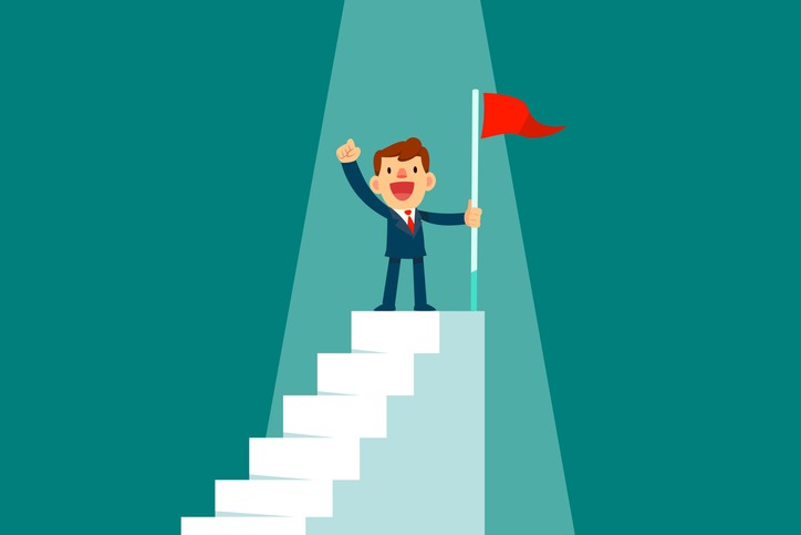 businessman holding flag on top of staircase
