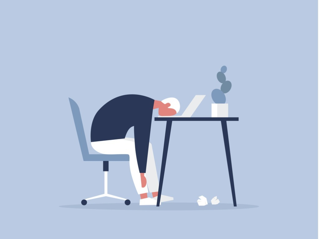 professional-burnout-young-exhausted-manager-sitting-at-the-office-vector-id1084925542 (1)