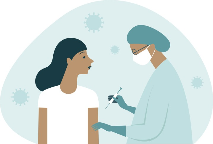 Doctor in protective suit inject vaccine shot to patient. Iimmunitystimulationto minimize risk of coronavirus infection. Covid-19 vaccination concept.