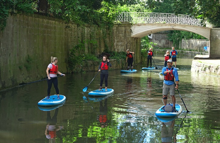 Paddle boarders on the Kennet and Avon Canal