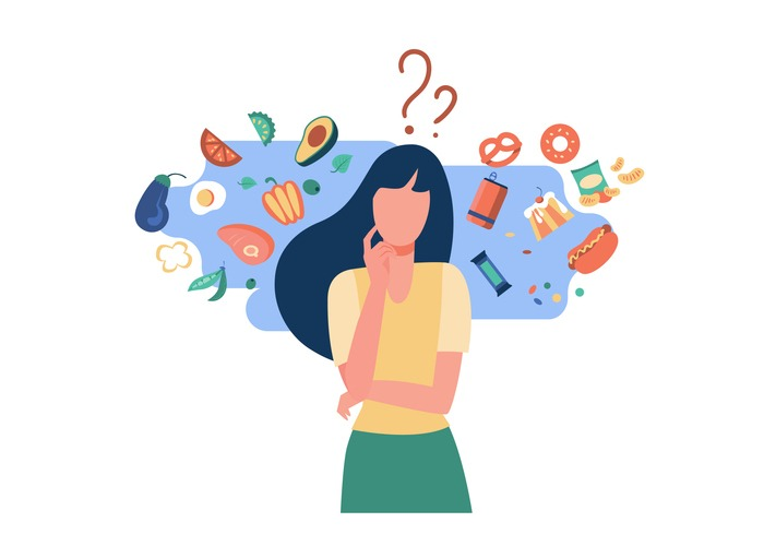Woman choosing between healthy and unhealthy food