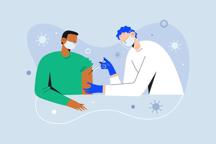 Coronavirus vaccination, doctor injecting a patient, getting first shot of covid vaccine in arm muscle. Medical doctor in protective suit and mask, process of immunization against covid-19