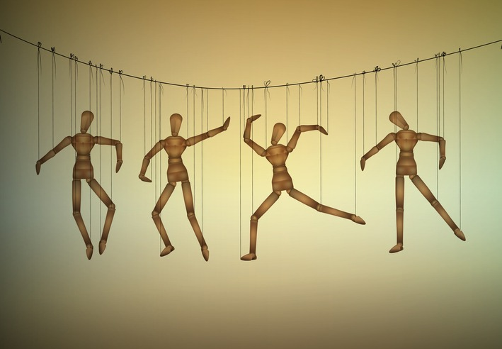 many marionette in different positions hanging on the threats, manipulate the people concept,