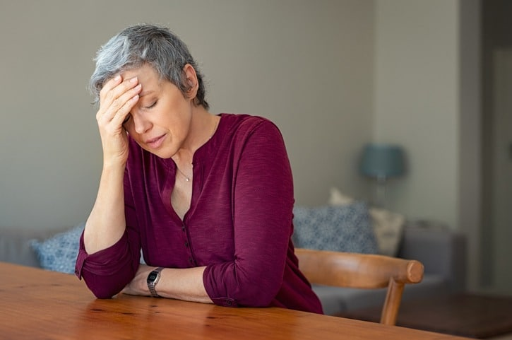 Stressed senior woman at home