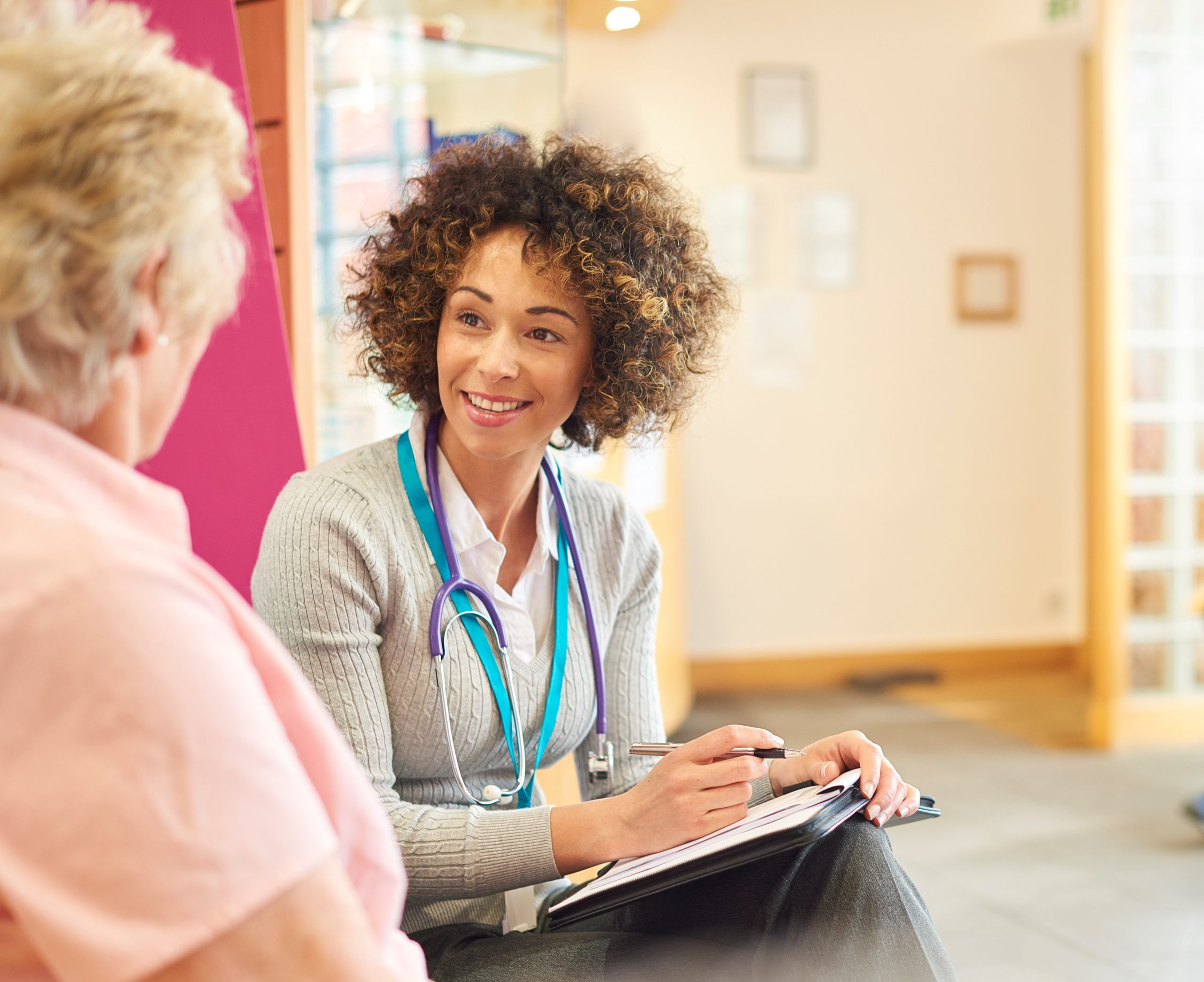 Chatting to senior patient in the waiting room