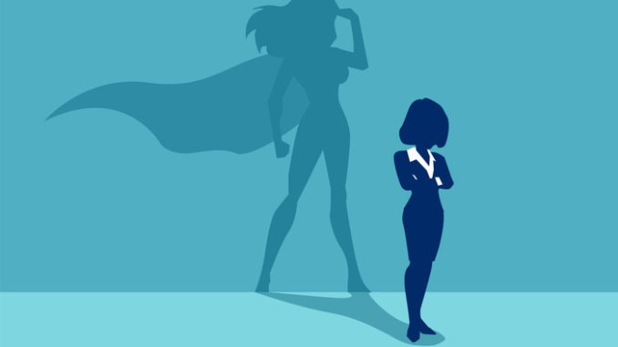 A person. The shadow behind them is a superhero in a cape.