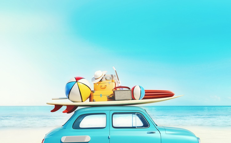 Small retro car with baggage, luggage and beach equipment on the roof, fully packed, ready for summer vacation, concept of a road trip with family and friends, dream destination, very vivid colors with dominant blue sky and ocean and bright blue car.