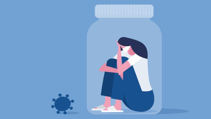 person in a jar looking at a COVID particle