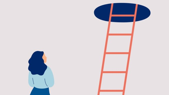 A person looks at a ladder
